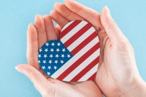 hands holding American flag