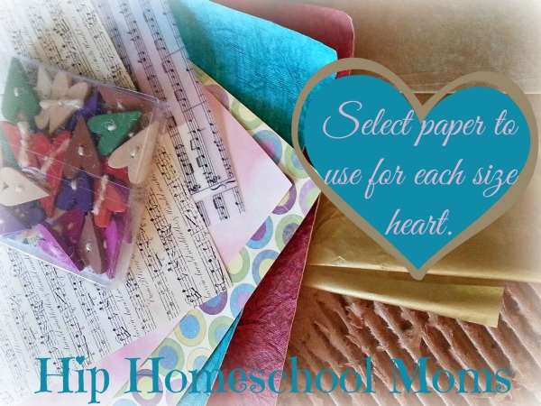 To make Torn and sewn paper hearts, begin by selecting paper to be used for each size heart. | Hip Homeschool Moms