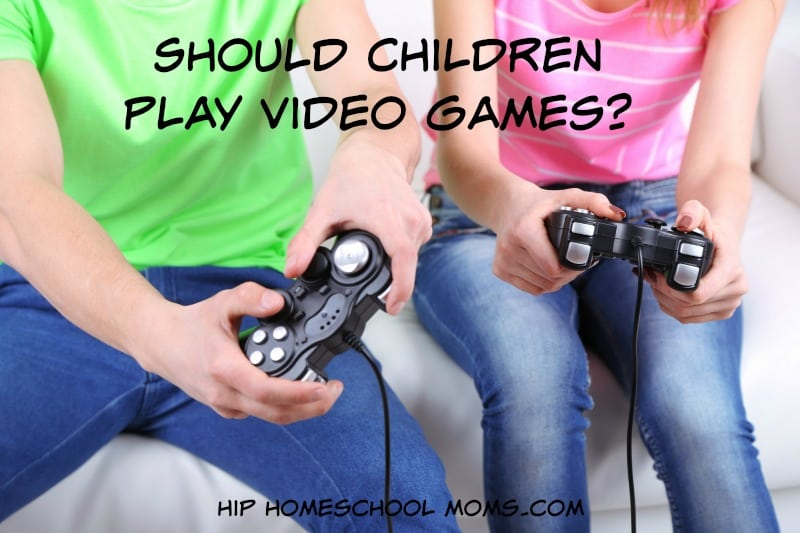 Girl and boy playing video games at home