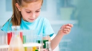 young girl doing a science experiment