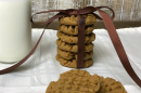 Flourless Peanut Butter Cookies Recipe a stack of cookies tied with a brown bow on a white tablecloth