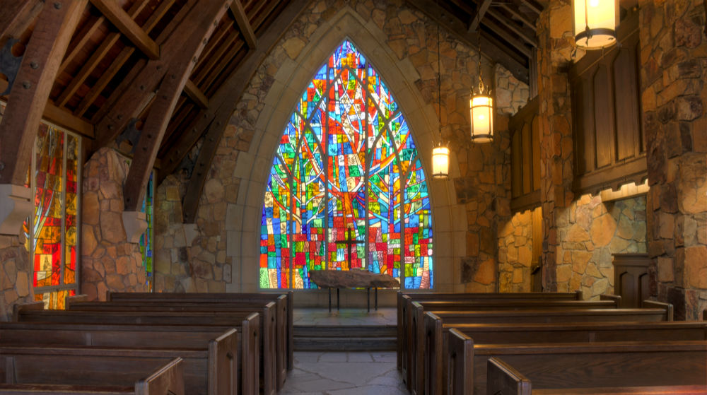 Gorgeous vibrant stained glass windows inside Callaway chapel in Callaway Gardens GA