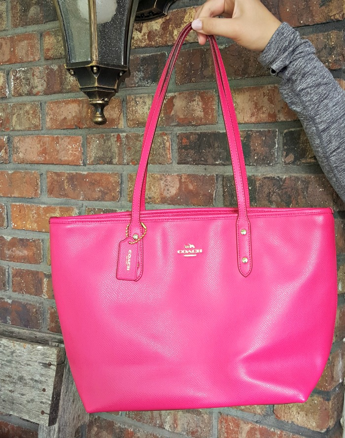 Enter this giveaway to win this hot pink coach tote