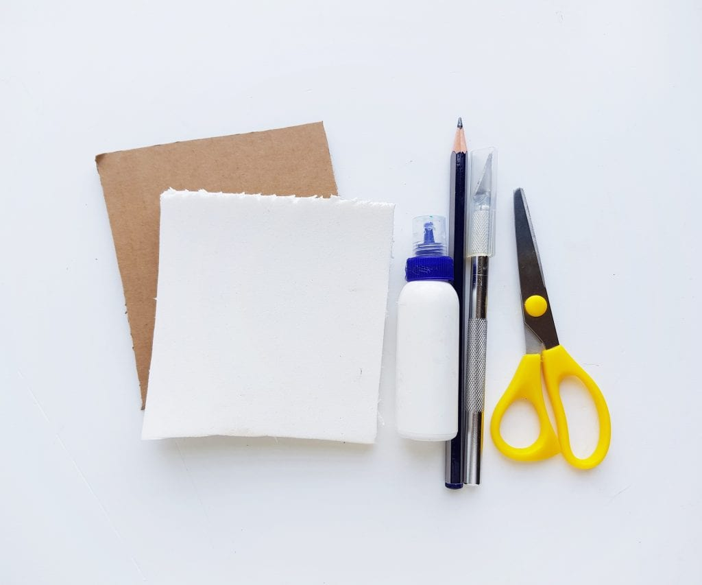 supplies for making DIY snowflake stamps