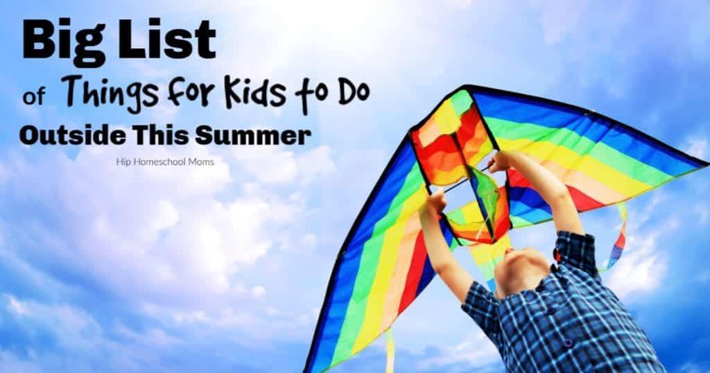 child flying kite in summer